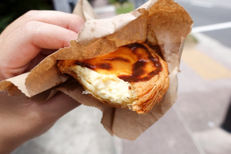 Madeleine's egg tart-bitten into