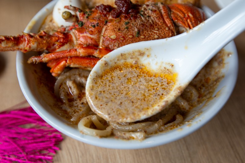 Spoonful of laksa gravy from Lime Restaurant Parkroyal Collection Pickering 17