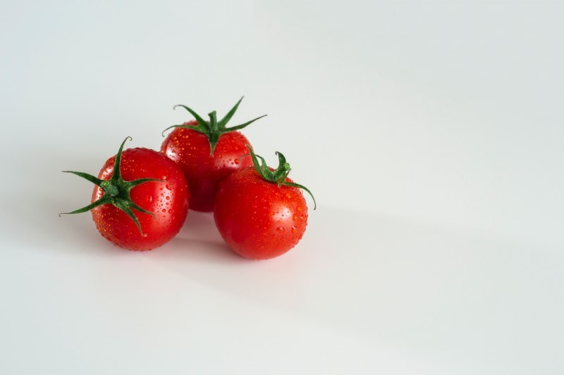 Three small red tomatoes