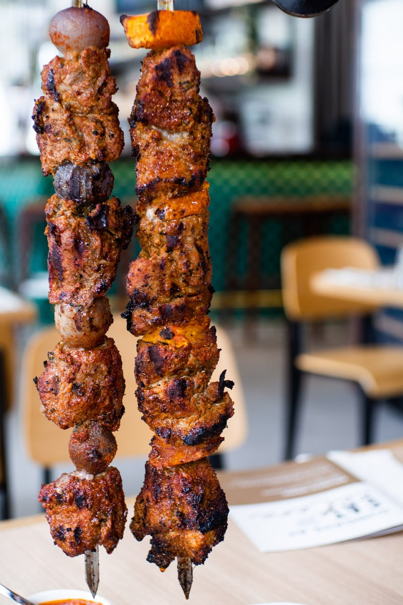 hanging skewers of pork collar and lamb