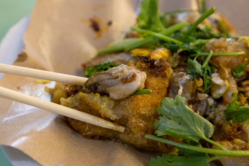 Chopstick holding oyster omelette from Old Airport road