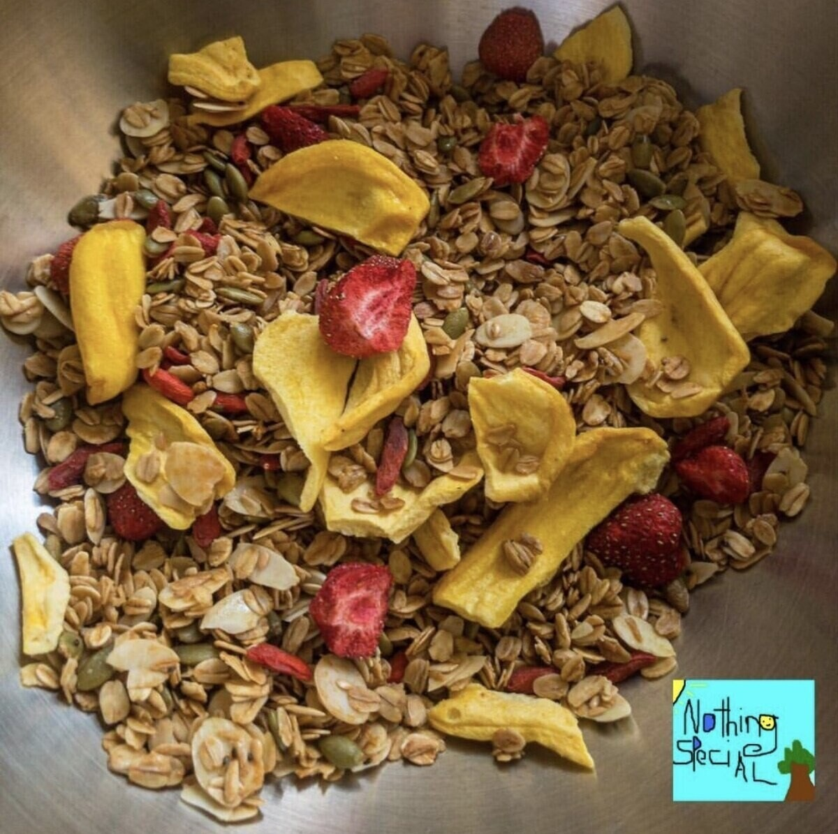 A bowl of granola with bananas and strawberries