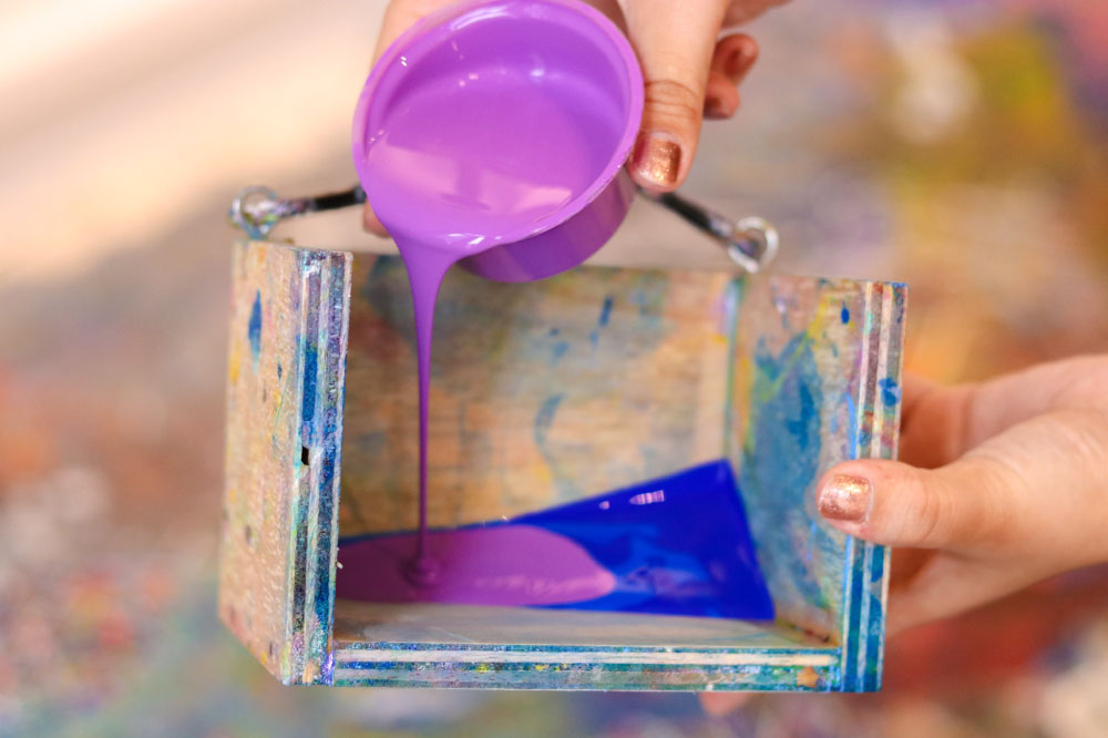 pouring paint into the pendulum
