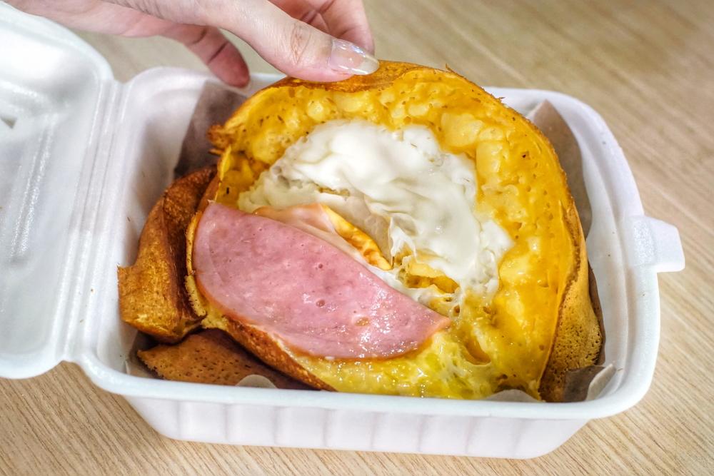 inside egg, ham & cheese Min Jiang Kueh